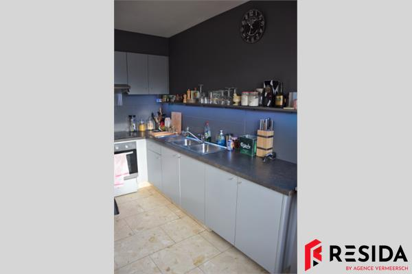 Gemoderniseerd éénslaapkamerappartement met garage